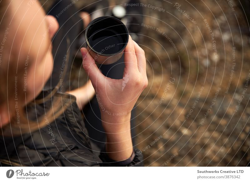Close Up Of Woman Taking A Break From Countryside Hike And Drinking Coffee From Flask coffee walking woman young women hike hiking trek camping taking a break