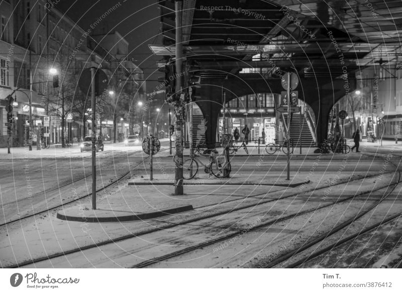 At night at the snowy crossing Schönhauser Allee at the corner of Eberswalder Berlin Prenzlauer Berg Winter Snow Night Train station Black & white photo