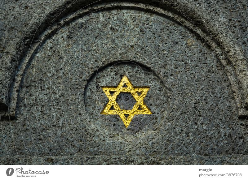 A golden Star of David on a building Israel Building Grave Monument Building stone Religion and faith Landmark Manmade structures Tourist Attraction Historic