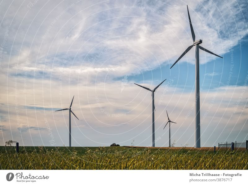 Wind turbines on the field Wind energy plant windmills Renewable energy Technology Energy industry Agriculture sustainability Electricity stream Fence Field Sky