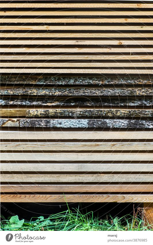 Stacked boards in three different variations. Board stacks Wood rough sawed Nature Dry neat Arrangement larch wood spruce Parallel about each other bark