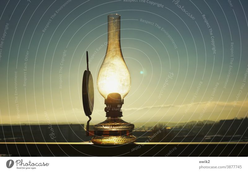 energy-saving lamp Old luminescent Brilliant Sun Sunlight Translucent Mysterious Cloudless sky Horizon Town Balcony Above wide silent Lens flare Glass Metal