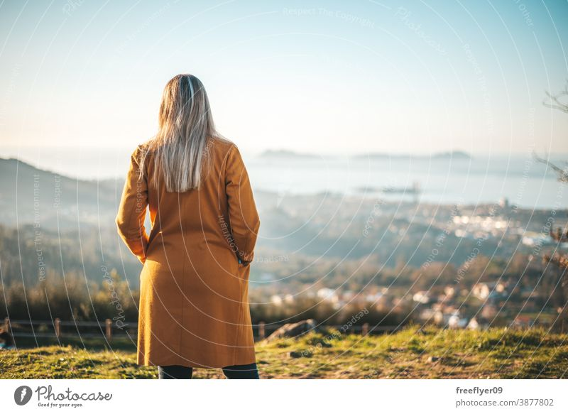 Woman on a yellow coat contemplating the landscape woman winter autumn vigo galicia nature outdoors freedom sunset contemplation sky coolness countryside leaf