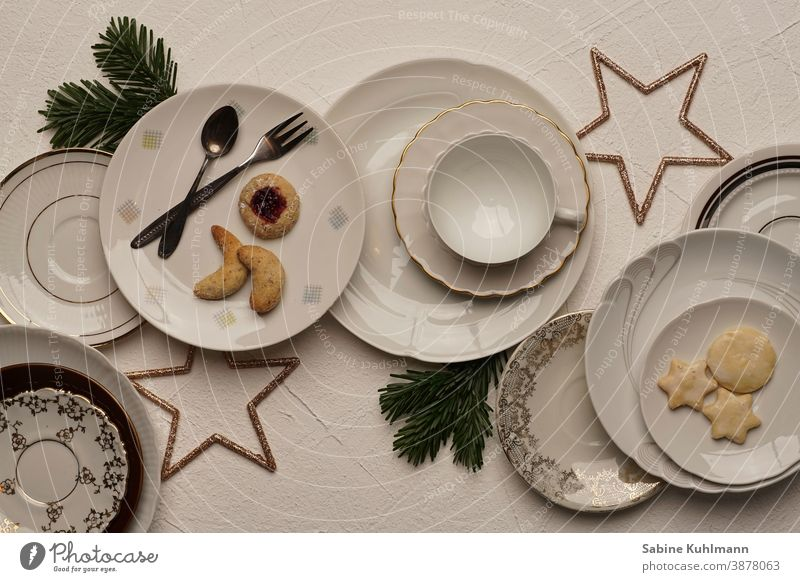 Various plates with pastries and Christmas decoration plate with white background Plate Coffee cup Coffee table coffee service Colour photo To have a coffee Cup
