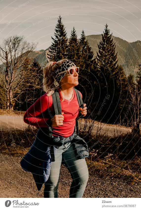 Young woman hiking in autumn schliersee sharpened Hiking autumn colours Autumn Athletic outtdoor Backpack Trip Adventure Sports Movement hiking tour Mountain
