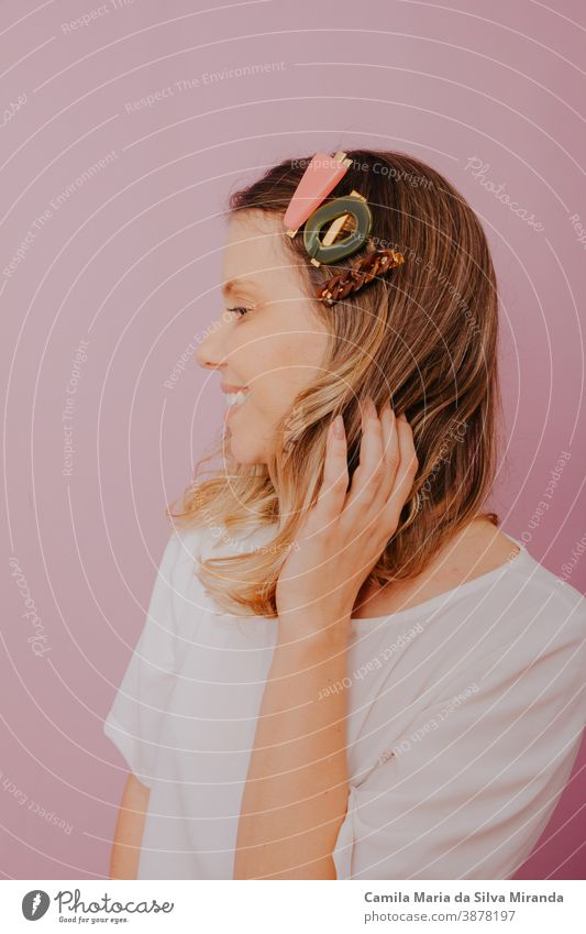 Blonde Woman with Clips in her hair, modern hair pins, pink background accessories blonde clip close-up copy space editorial fashion fashion photography