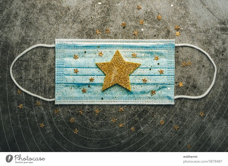 Christmas concept background.Protective surgical mask with christmas star coronavirus covid covid-19 christmas tree christmas background xmas christmas gifts