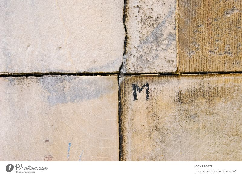 capital M written on a wall Wall (barrier) Sharp-edged Weathered Ravages of time Part Seam Detail Structures and shapes Surface structure Simple Street art