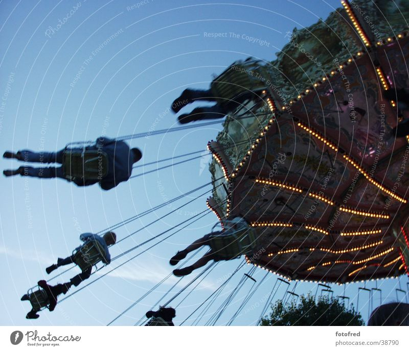 chain carousel Carousel Fairs & Carnivals Leisure and hobbies Feasts & Celebrations Human being Flying Sky Blue Joy