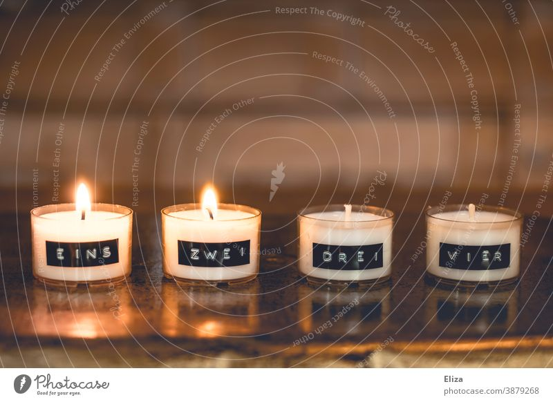 Two candles are burning on a minimalist Advent wreath, consisting of numbered tea lights Christmas wreath two 2nd Advent Second Advent Tea lights Burn
