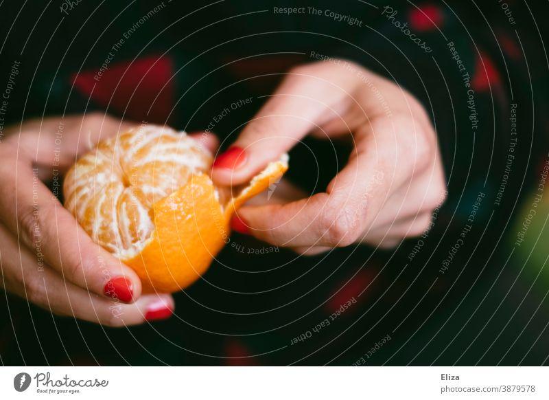 A woman's hands peel a tangerine Tangerine Nail polish Woman fruit cute Fresh Delicious vitamin V Orange clementine citrus fruit red nail polish Fruit Winter
