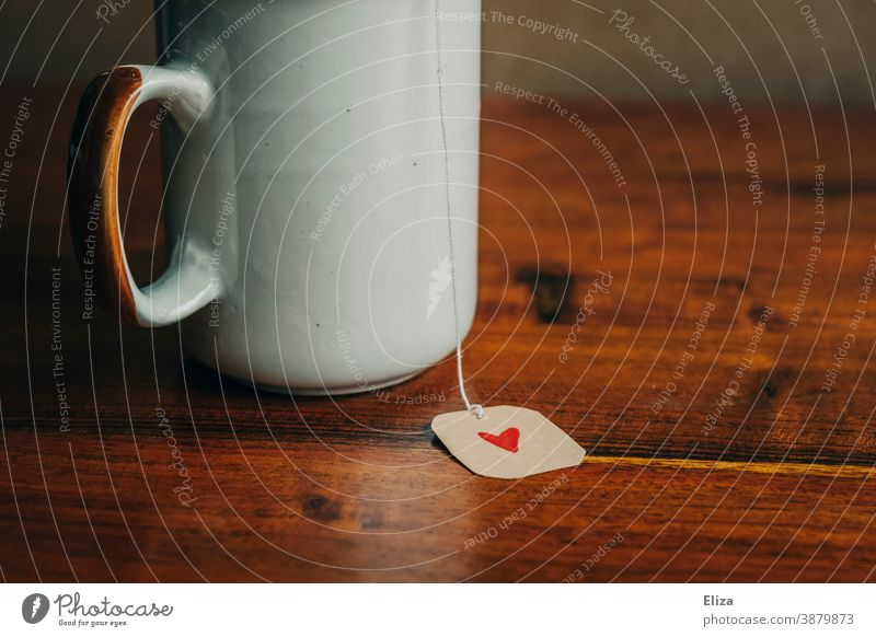 Teacup with a label of a tea bag on which a small red heart is painted Heart Tea cup Label Love affectionately Gift Painted Red Cozy Teatime Cup Valentine's Day