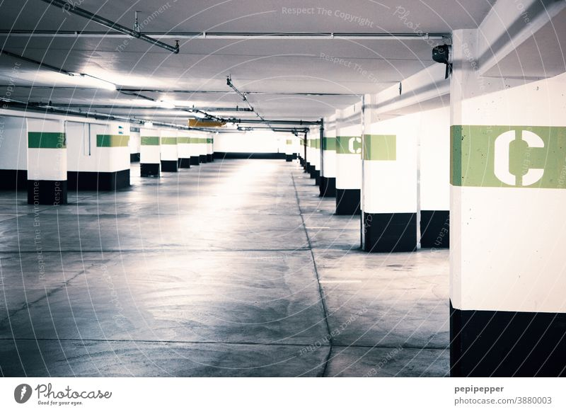 Underground car park with coloured letter identification Underground garage Garage Parking garage Concrete Parking lot Parking level Wall (building) Asphalt