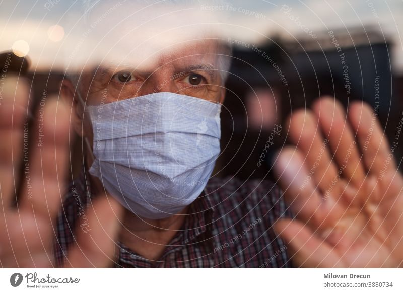 Elderly caucasian man wearing hand made protective face mask anxious care contagious corona coronavirus covid-19 crisis deadly depressed depression disease