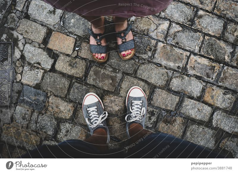 Man and woman photographed from above on feet Feet up Human being Exterior shot Vacation & Travel Colour photo Toes Footwear Sandals Sneakers sneakers