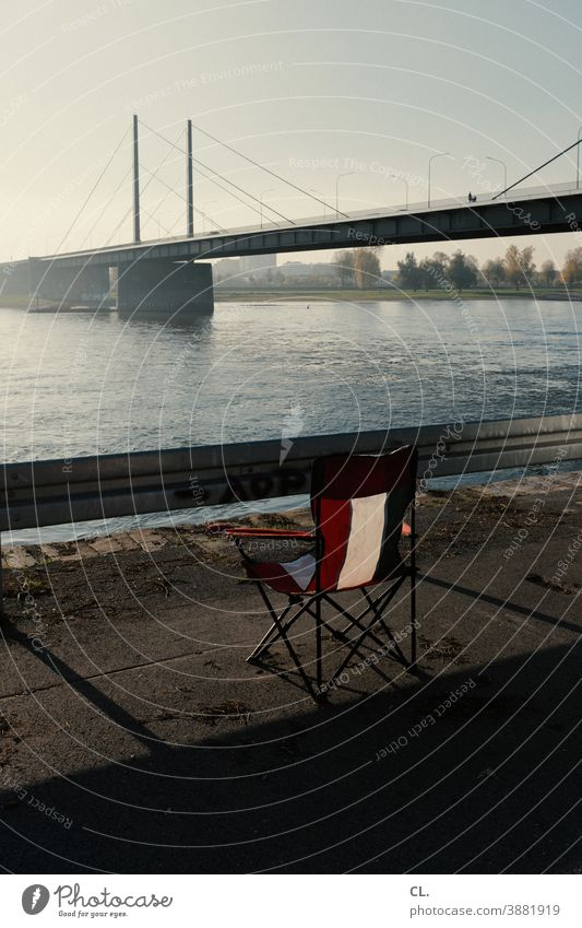 modest outlook River Chair Camping chair Vantage point Folding chair Bridge Duesseldorf Water Crash barrier Rhine Wanderlust Longing Beautiful weather