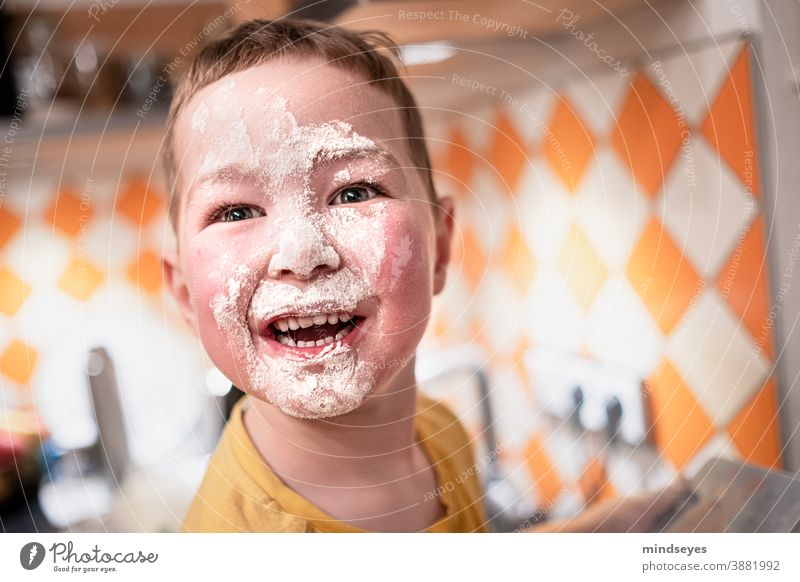 Little boy baking with flour on his face make Christmas Christmas baking Baking Flour muck about fun Playing Happy Child Infancy Joy Lifestyle Christmas biscuit