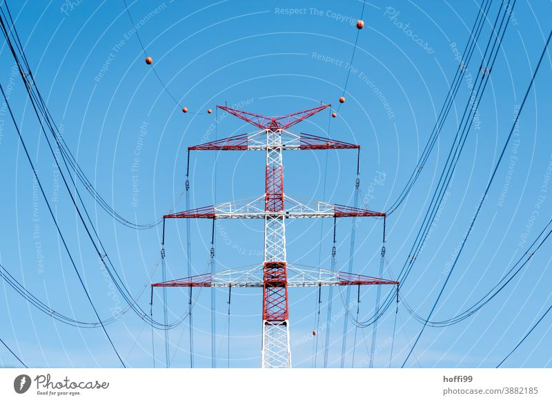 red white high voltage pylon in front of a clear blue sky Electricity pylon High voltage power line Transmission lines Energy industry Overhead line