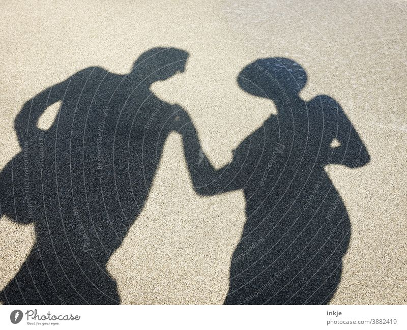 undressed shadow with hat and sunglasses Colour photo Shadow Silhouette Beach Tourism Sun vacation Couple at the same time NUDISM Copy Space Anonymous Touch Man
