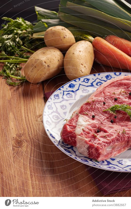 Raw meat and vegetables on table set raw fresh potato carrot leek food ingredient steak uncooked assorted meal cuisine beef dish various recipe prepare culinary