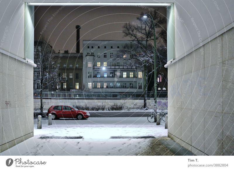 Winter in Schönhauser Allee . It is night . Berlin Night Avenue city Prenzlauer Berg Downtown Exterior shot car passage Goal Capital city Town Old town Deserted