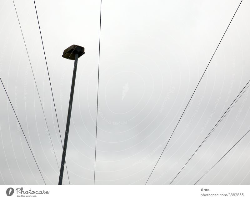 light boxes (24) Lamp Sky street lamp Lantern Old daylight Tall Worm's-eye view Clouds cloudy Cable power line Electricity Transport transmission line