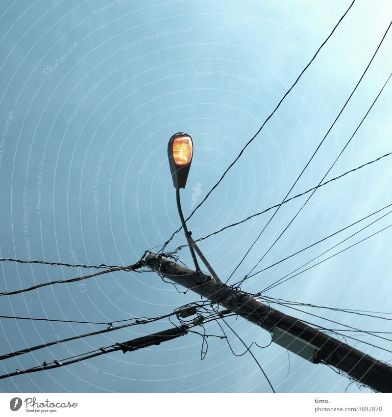 light boxes (24) Lamp Sky streetlamp sunny Construction Suspension Lighting Tall Above Worm's-eye view Cable Electricity pylon transmission line Whimsical