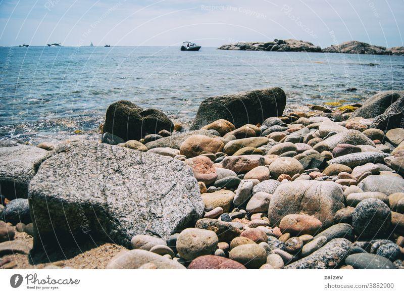 Close-up of some pebbles on the seashore taken at ground level costa brava calella de palafrugell palamós landscape views water mediterranean catalonia seascape