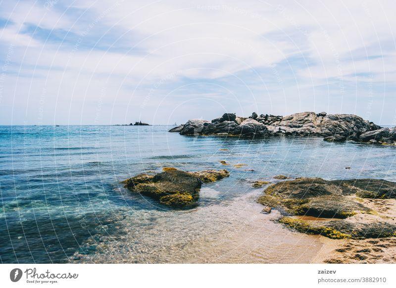 Seascape of a beautiful cove with some steep rocks in the water costa brava calella de palafrugell palamós landscape views sea mediterranean catalonia shore