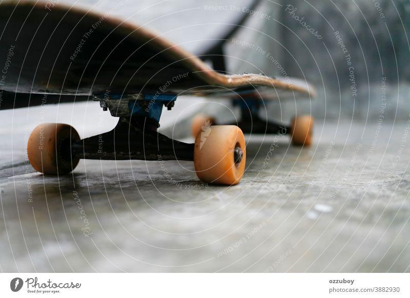 close up side view skateboard sport wheel youth extreme black skateboarder skateboarding closeup culture park horizontal jump balance shadow tail workout angle