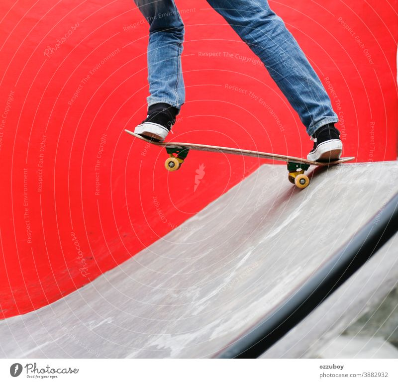 Skater playing skateboard in the park with red wall background Sports Wheel youthful Extreme Ice skate Black Board Skateboard skateboarder Skateboarding