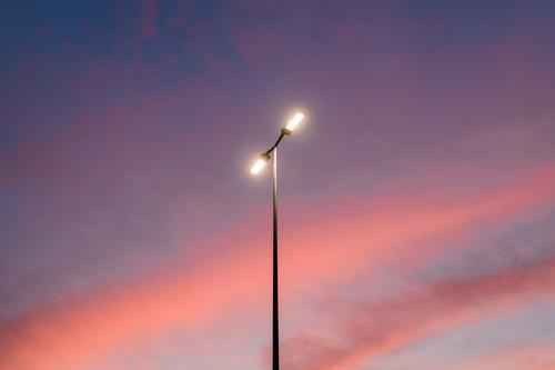 View of the streetlight in a beautiful sunset sky abstract background blue bright cloud clouds cloudscape color colorful dawn design dusk electrical electricity