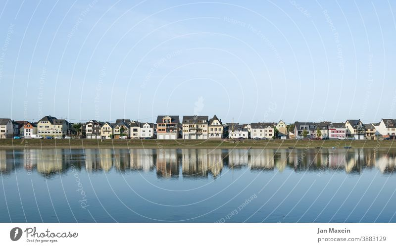 Reflection of a small town in the river House (Residential Structure) Water reflection boat Sky Blue Town Village Housefront houses Tourism Building River