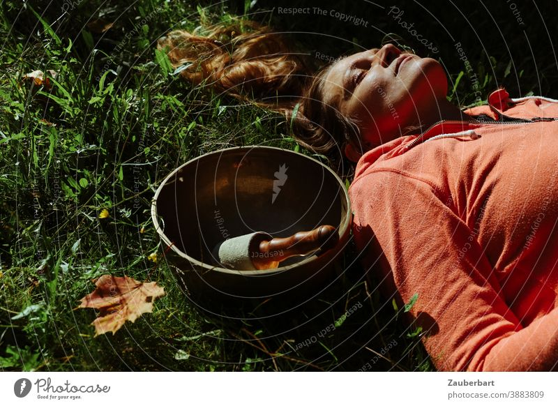 Beautiful woman with singing bowl and autumn leaves in the grass Woman pretty Grass Leaf Autumn Sun Meditation Wellness relaxation Sound Bowl Contentment Calm