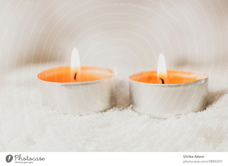 Two orange tea lights burning in the snow Tea warmer candle Tea lights candles Spa Snow Christmas Advent Wellness Flame Wick shoulder stand Christmas & Advent