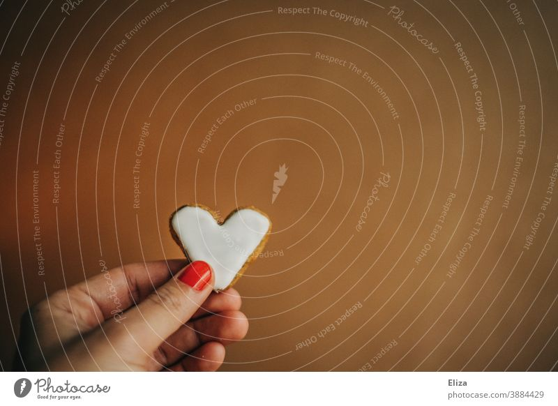 Female hand holding a heart-shaped cookie with white icing for Valentine's Day or Mother's Day Cookie Heart Heart-shaped Love Delicious cute nibble Candy