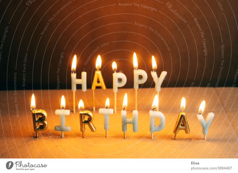 Burning Happy Birthday candles cauterizing shoulder stand birthday candles lettering writing