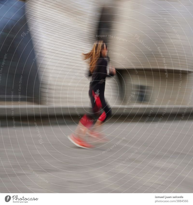 runner on the street in Bilbao city, Spain running marathon jogging action fitness health lifestyle person human sport exercise speed fast blur blurred motion
