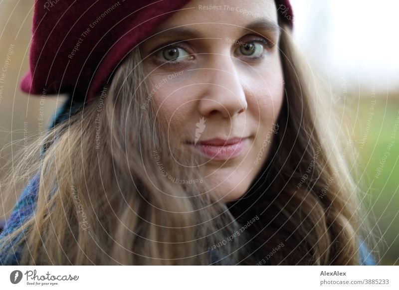 Close portrait of a young woman with hat Woman Slim pretty Brunette long hairs Face smart emotionally see look Looking Direct naturally Fair-skinned pale