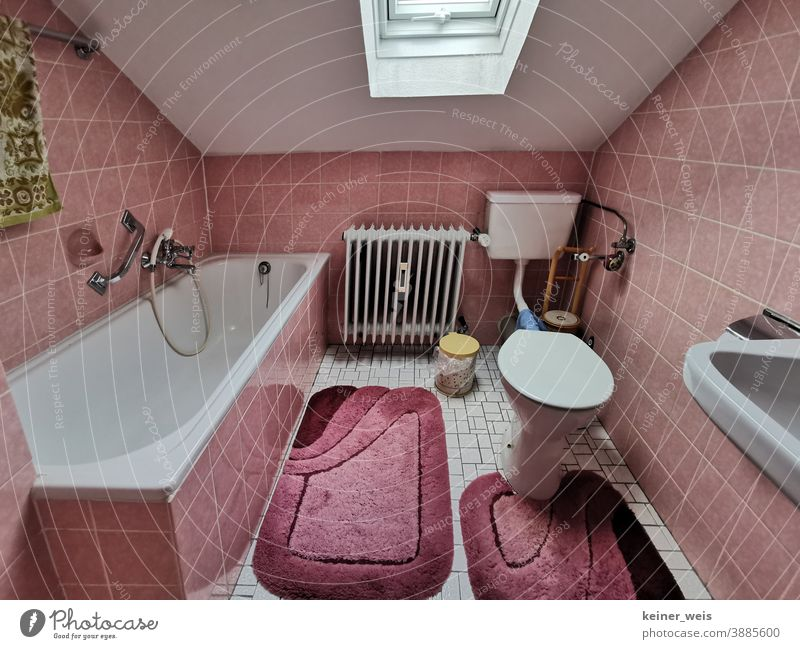 Old bathroom under the roof in old pink shades Bathroom Toilet Bathtub tiles Tile Pink Old building Cheap Rent Heater Sink Shower Sanitary Skylight Carpet