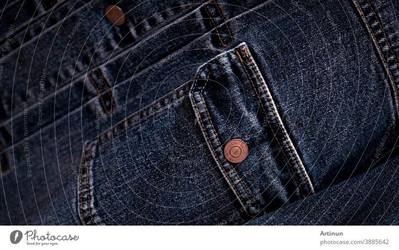 Selective focus on denim jean jacket pocket in clothes shop. Denim jacket pocket and button texture. Textile industry. Jeans fashion and shopping concept. Clothing concept. Denim jacket for sale.