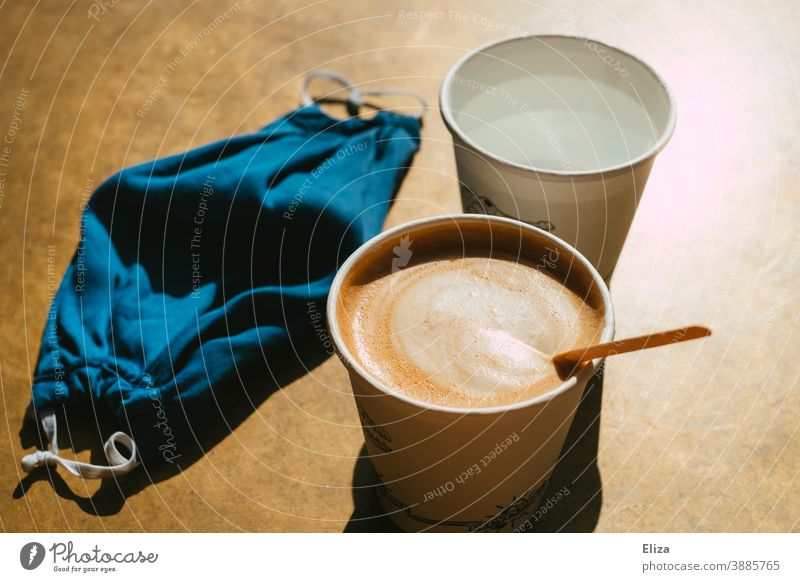 Drinking coffee to go, because of Corona to stay is not allowed Coffee take away Café Gastronomy corona Mask fabric mask disposable tableware Paper cup