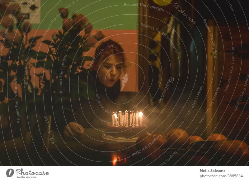 young woman blowing out her birthday cake candles roses gift present Birthday Birthday cake Feasts & Celebrations Cake Candle Colour photo Joy smoke hazy