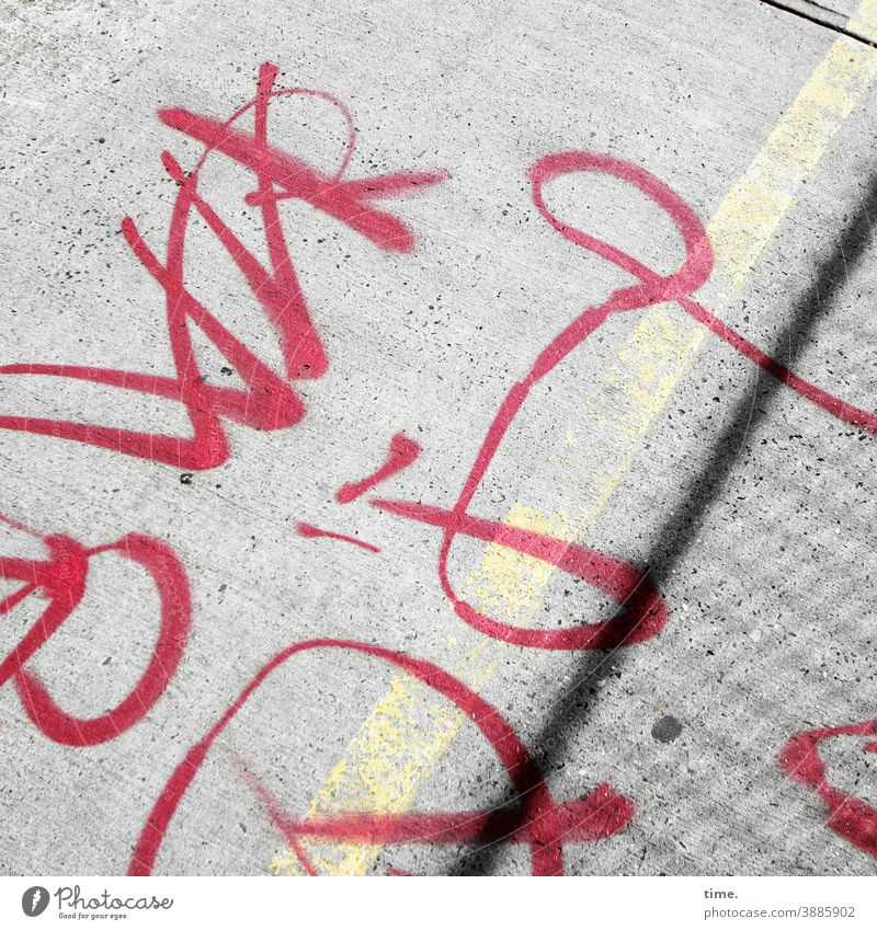 system relevant | characters Characters writing Text Ground Street sales Driveway Sidewalk Red Line Word graffiti symbol Sign Hard sunny Coating embassy