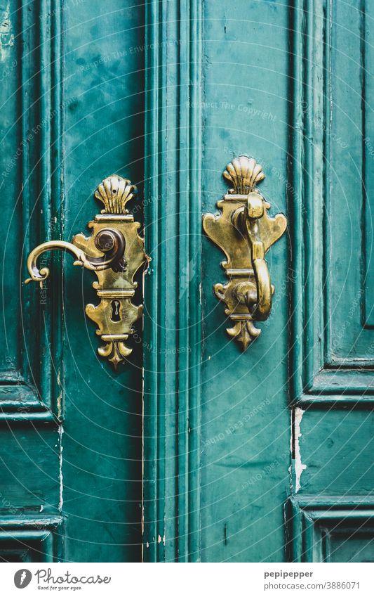 old gold door handle Door handle Old Deserted Entrance Wood Wooden door Structures and shapes Wooden gate Closed Front door Exterior shot Detail Metal Lock