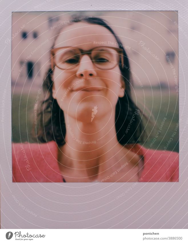 Polaroid selfie. Woman with glasses and brown hair in front of a house. Head up Selfie Self-confident Smiling Impish Eyeglasses Neck Face Brunette gray hair