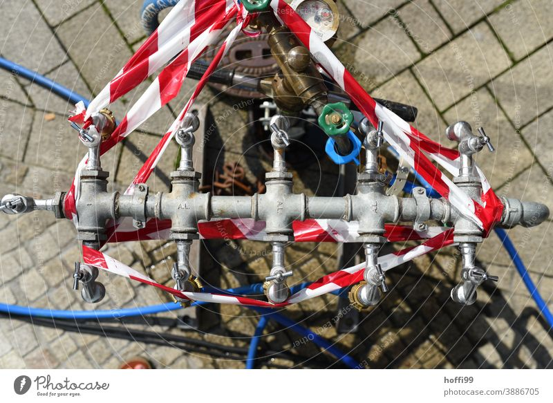 Hydrant with flutter band Fire hydrant flutterband Reddish white White cordon Water supply Construction site barrier tape Safety Protection prevention