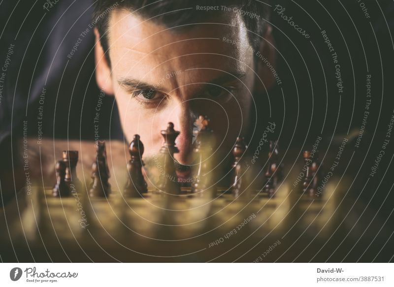 Man plays chess Prospect of success Success strategy concept planning Safety Playing challenge Chess Chessboard Intellect Think strategist Ambitious Duel