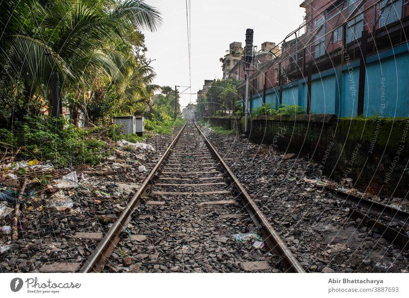 Empty railway tracks creating vanishing point. Indian railways and transport summer street urban background direction empty industry iron journey landscape line