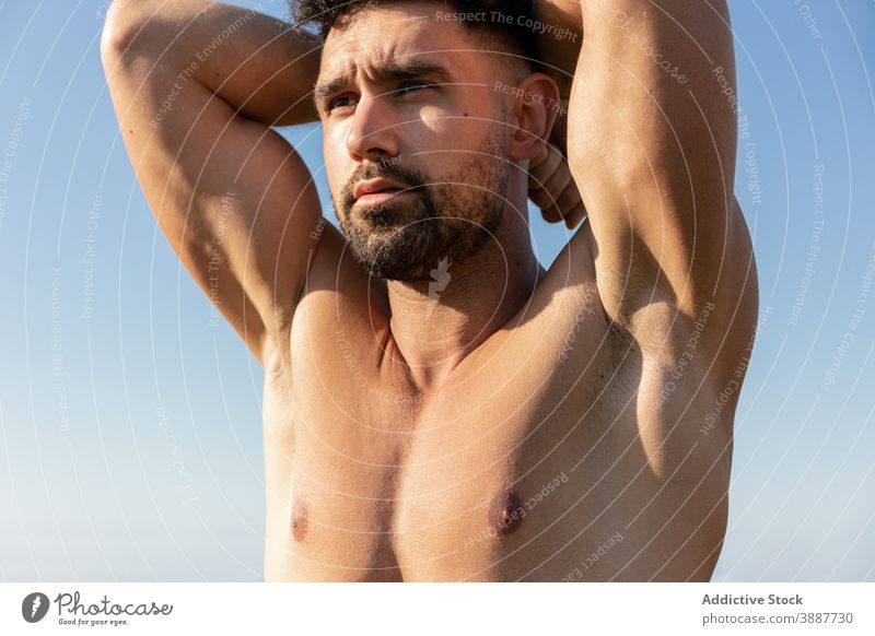 Muscular man with naked torso standing in nature shirtless sportsman bodybuilder muscular strong handsome determine athlete male fit beard wellness wellbeing